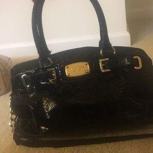 Michael Kors Black snack skin purse